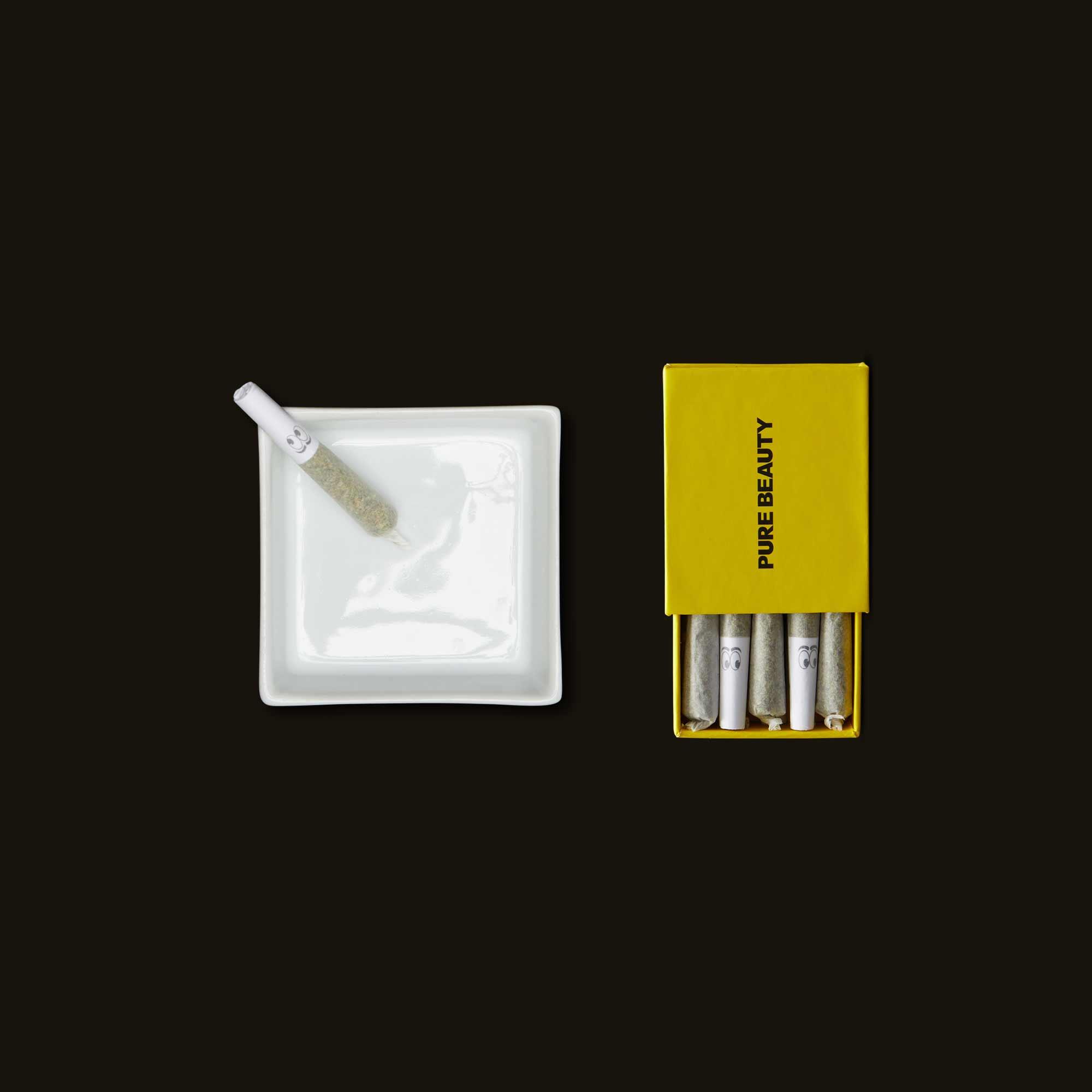 Sativa mini pre-roll in an ash tray